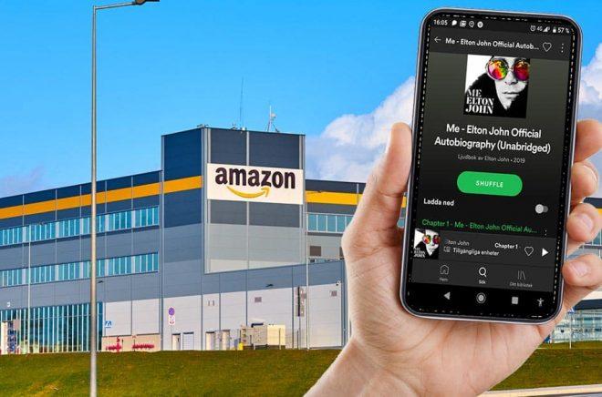 Amazons lager Kolbaskowo, i Polen. I förgrunden Spotifys mobilapp där man bland annat kan lyssna på hela ljudboksutgåvan av Elton Johns Me från hösten 2019. Foto: iStock. Montage: Boktugg.