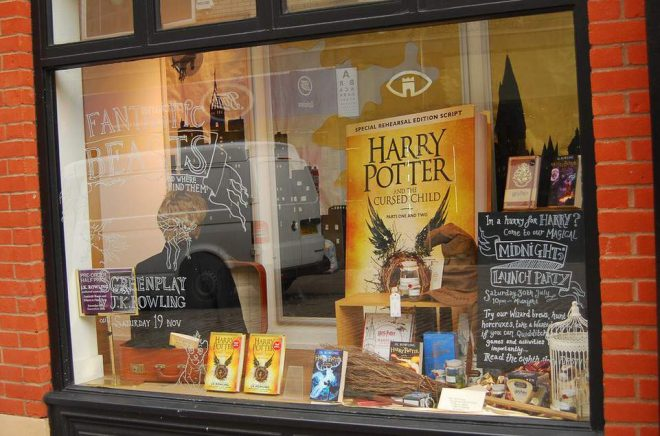 Norwich, United Kingdom- August 1, 2016: Window at Bookstore in Norwich advertises the new book on the Harry Potter series